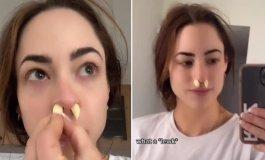 فتاة تضع الثوم في أنفها.jpg